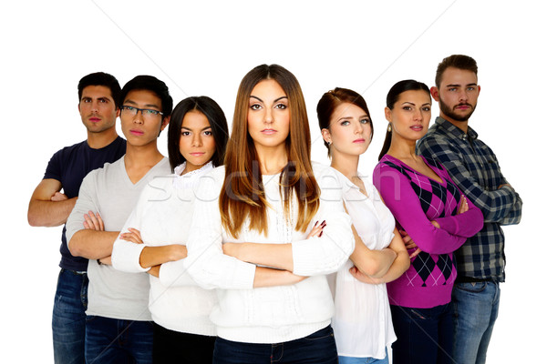 Serious woman leading her team over white background Stock photo © deandrobot