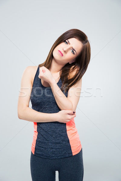 Esportes mulher dor cotovelo cinza olhando Foto stock © deandrobot