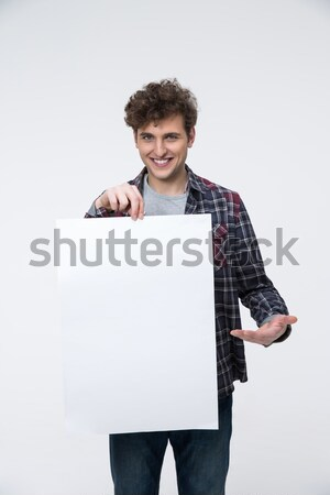 Gülen adam kıvırcık saçlı ilan panosu arka plan Stok fotoğraf © deandrobot