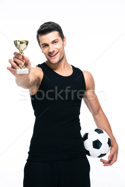 Football player holding winners cup Stock photo © deandrobot