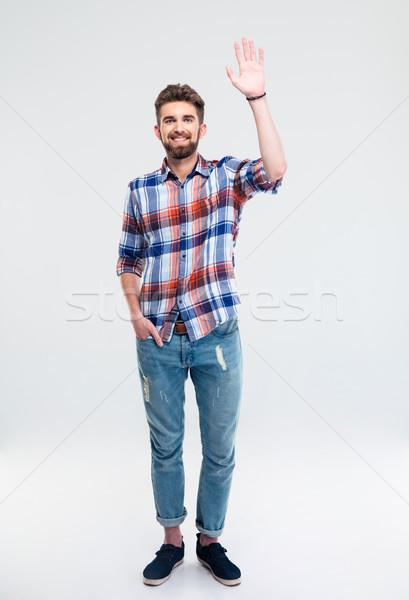 Stockfoto: Man · tonen · groet · gebaar · geïsoleerd