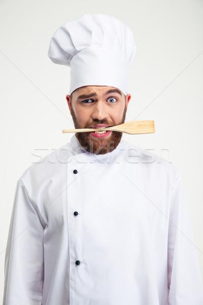 Mannelijke chef kok lepel tanden Stockfoto © deandrobot