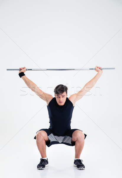 Fitness man squatting with barbell  Stock photo © deandrobot