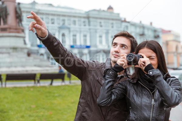 Couple making photo on camera outdoors Stock photo © deandrobot