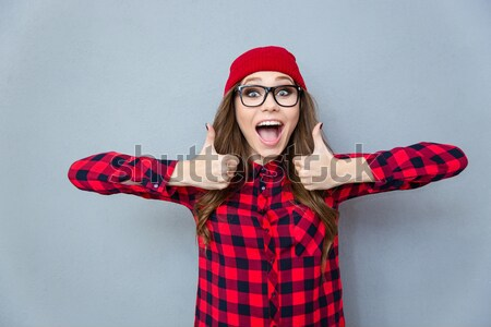 Dangerous agressive young man shouting and threatening with gun Stock photo © deandrobot