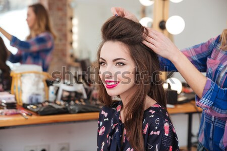 Attractive smiling young woman in beauty salon Stock photo © deandrobot
