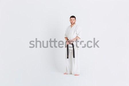 Teljes alakos portré férfi kimonó áll izolált Stock fotó © deandrobot