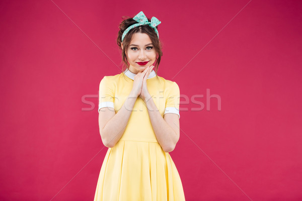 Happy beautiful pinup girl in yellow dress and headband Stock photo © deandrobot