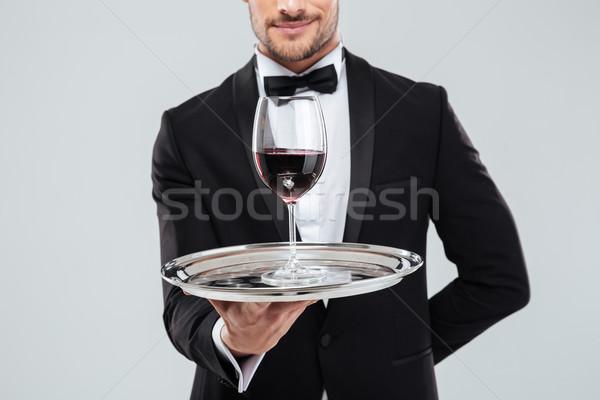 Komornyik csokornyakkendő tart ezüst tálca üveg Stock fotó © deandrobot