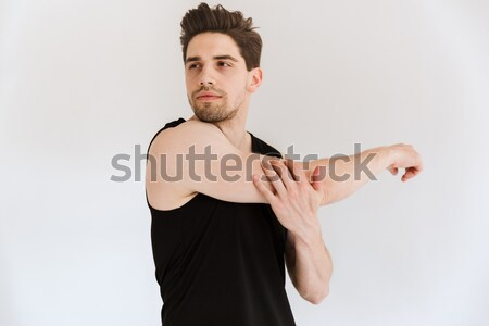 Relaxed young fitness man sitting in lotus pose and meditating Stock photo © deandrobot
