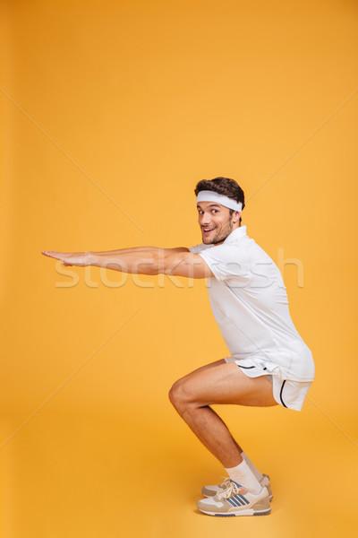 Stock fotó: Mosolyog · fiatalember · atléta · edz · citromsárga · sport