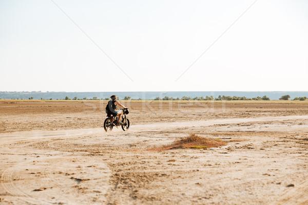 Férfi motorkerékpár sivatag rúg felfelé por Stock fotó © deandrobot