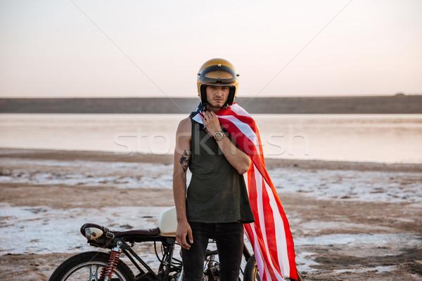 Man wearing american flag cape and golden helmet posing Stock photo © deandrobot