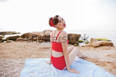 Young beautiful pin up girl biting pineapple outdoors Stock photo © deandrobot