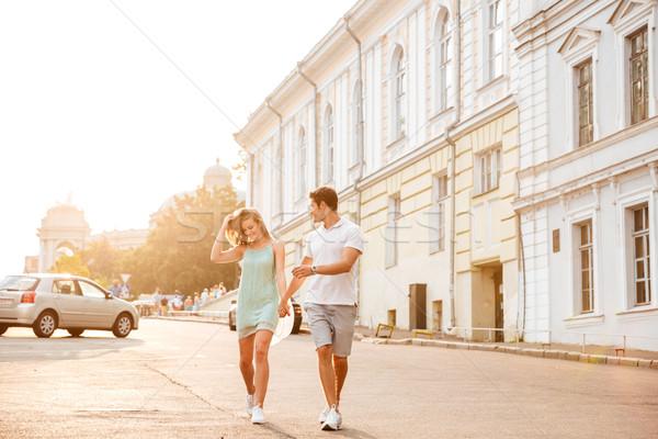 Feliz belo casal caminhada rua verão Foto stock © deandrobot