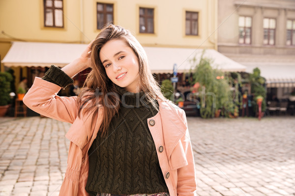 Attractive young woman at old city in spring Stock photo © deandrobot