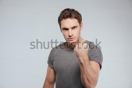 Portre ciddi gündelik adam yumruk Stok fotoğraf © deandrobot