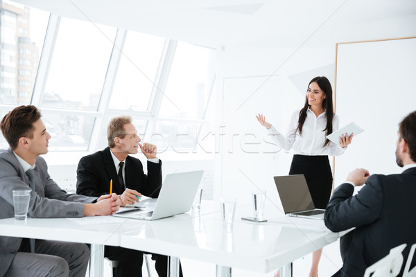 Speech of confidence woman on conference Stock photo © deandrobot