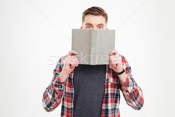 Młody człowiek shirt okładka twarz książki Zdjęcia stock © deandrobot