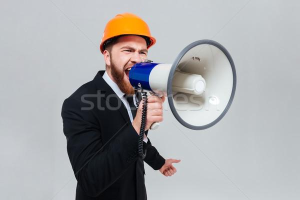 Engenheiro megafone barbudo terno preto laranja Foto stock © deandrobot