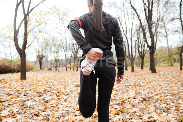 Cropped image of woman runner make sport exercise Stock photo © deandrobot