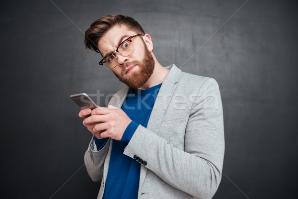 Funny hipster with phone Stock photo © deandrobot