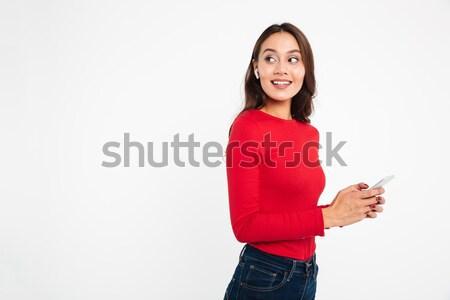 Játékos nő tart cukorka falat ajak Stock fotó © deandrobot