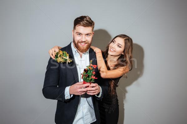 Happy smiling business couple celebrating new year Stock photo © deandrobot