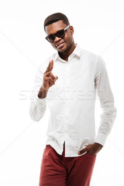 Cheerful young african man dressed in shirt Stock photo © deandrobot