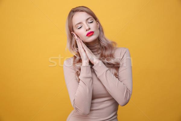 спальный молодые блондинка Lady ярко макияж Сток-фото © deandrobot