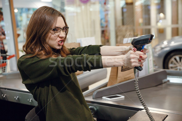 Cashier lady on workspace in supermarket shop have fun Stock photo © deandrobot