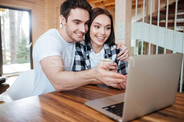hugging couple near laptop Stock photo © deandrobot