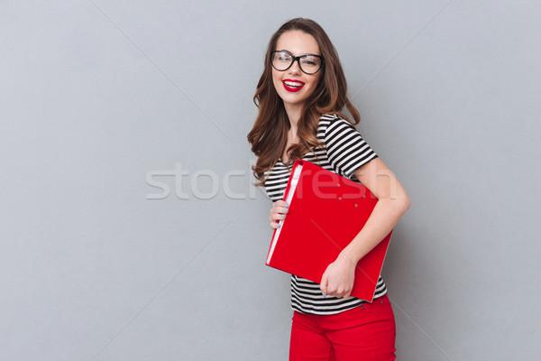 Felice donna ufficio cartella Foto d'archivio © deandrobot