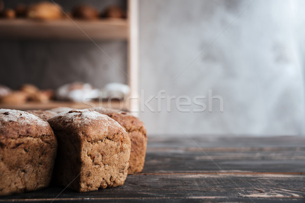Chleba mąka ciemne drewniany stół Fotografia piekarni Zdjęcia stock © deandrobot