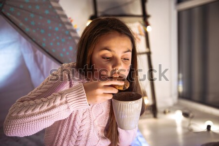 Cute girl in pink jacket covers her mouth with palm Stock photo © deandrobot