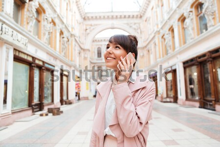 Stock photo: Girl listening to music with headphones and looking away outdoors