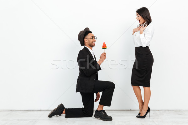 African business man gives ice cream to his colleague woman Stock photo © deandrobot