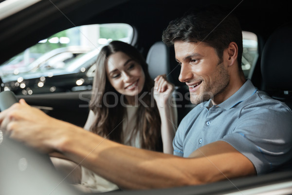 Couple sitting at the front seats of their new car Stock photo © deandrobot