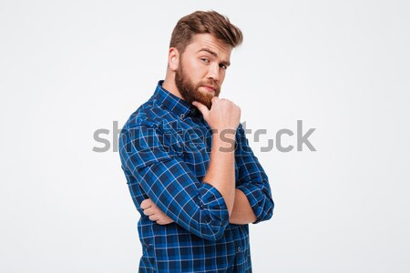 Thoughtful serious man posing isolated over white Stock photo © deandrobot