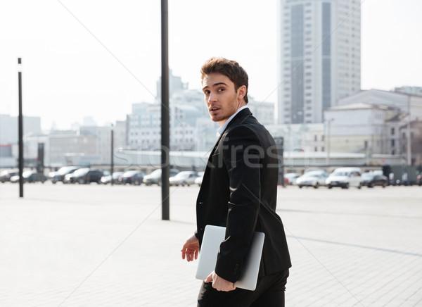 концентрированный молодые бизнесмен ходьбе улице изображение Сток-фото © deandrobot