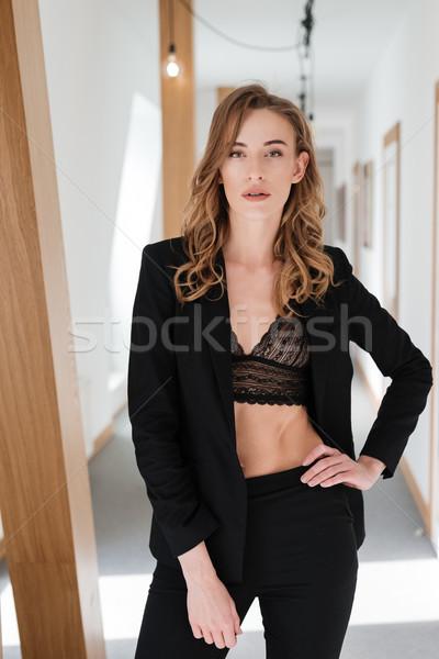 Imagen mujer bonita traje sujetador camisa posando Foto stock © deandrobot