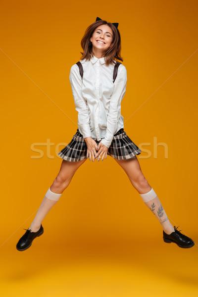 Retrato feliz funny colegiala uniforme Foto stock © deandrobot