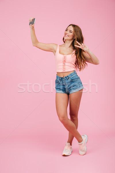 Retrato jóvenes sonriendo mujer verano Foto stock © deandrobot