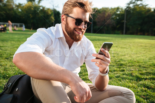 Happy bearded man in sunglasses and business clothes Stock photo © deandrobot