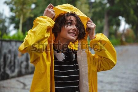 Portrait of an upset young teenage girl wearing raincoat Stock photo © deandrobot