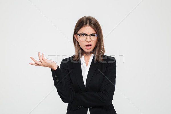 Portrait of a frustrated young businesswoman in suit Stock photo © deandrobot