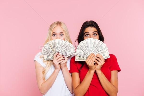 два удивленный женщины сокрытие за деньги Сток-фото © deandrobot