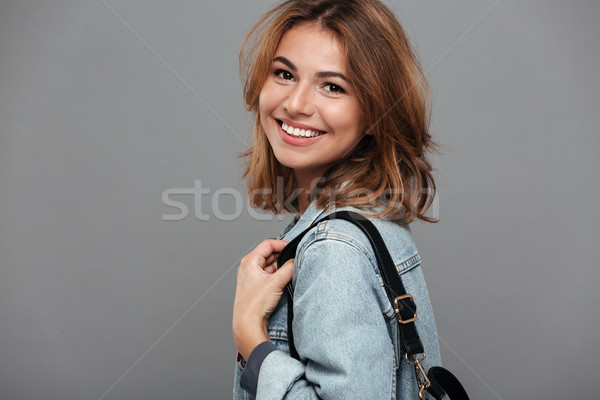 Close up portrait of a pretty girl in denim jacket Stock photo © deandrobot