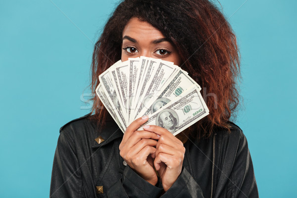 Mystery african woman in leather jacket hiding behind a money Stock photo © deandrobot