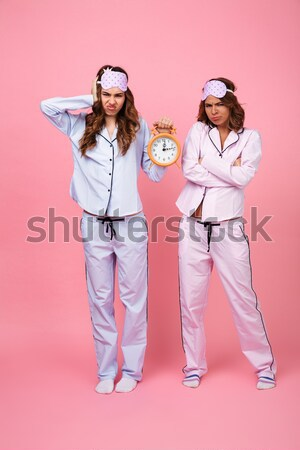 Shocked confused screaming friends women holding alarm clock Stock photo © deandrobot